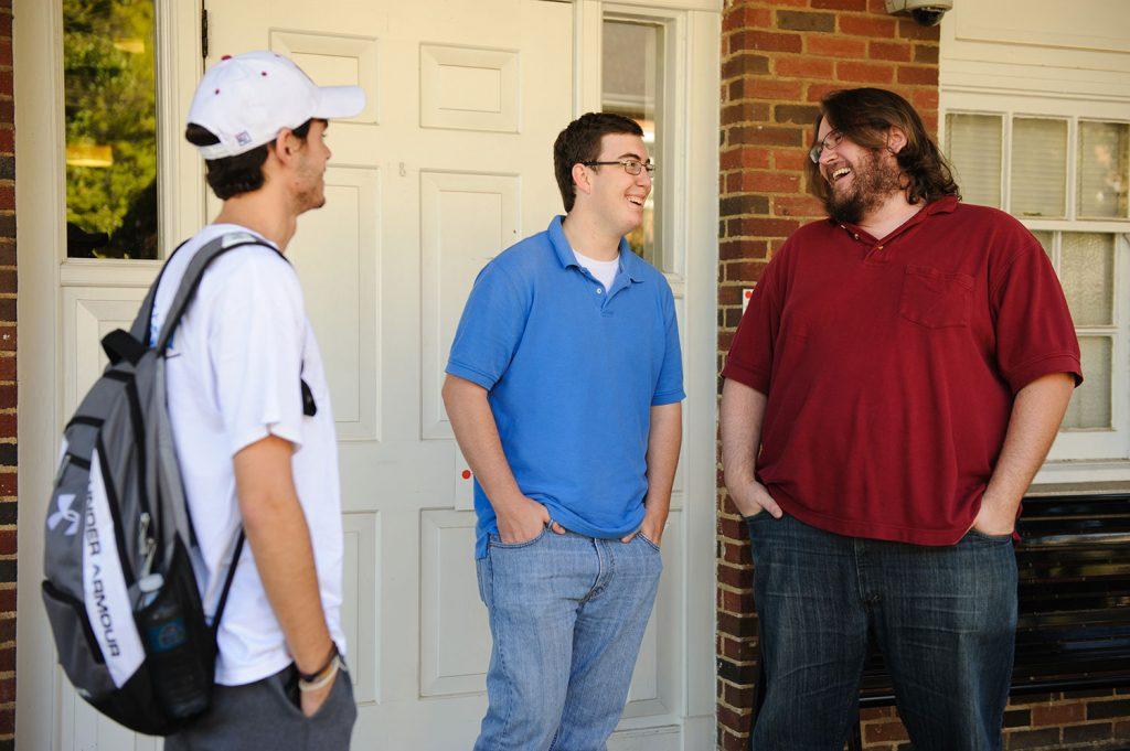 Parker-Adams students talking outside Harris Hall
